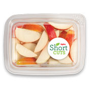 top view of a plastic container with apples slices in it