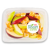Red and green apple slices in a container with chunks of colby jack cheese