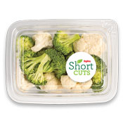 broccoli and cauliflower florets in a plastic container