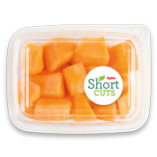 top view of a plastic container with cut up cantaloupe