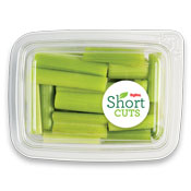 Sticks of celery that have been cut and placed in a plastic container
