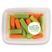 Top view of a container filled with carrots and celery slices