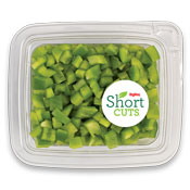 Green peppers that have been diced into small pieces and placed in a plastic container
