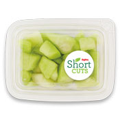 cut up honeydew melon in a plastic container