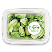 sliced up brussels sprouts in a plastic container