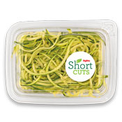 Zucchini that has been cut into noodles and placed in a plastic container
