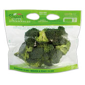 Clear plastic bag filled with broccoli florets