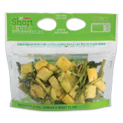 Summer squash, zucchini, and asparagus pieces in a clear plastic bag