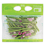 Green beans and sliced red onions in a clear plastic bag