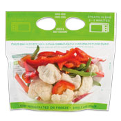 Cut green and red bell peppers with cauliflower in a clear plastic bag