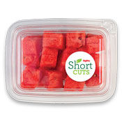 top view of a plastic container containing watermelon chunks