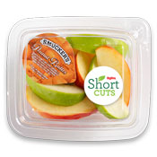 Apple slices with a travel container of peanut butter in a plastic container