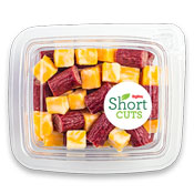 Cut beef sticks and cubed cheese in a plastic container