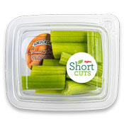Cut celery sticks in a plastic container with a travel container of peanut butter