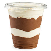 A cup of chocolate pudding with layers of whipped topping