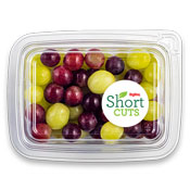 Green and purple grapes in a plastic container