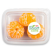 Peeled mandarins in a plastic container