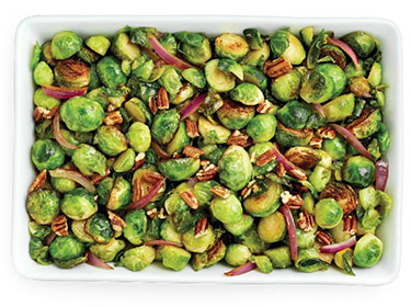 a large platter full of caramelized brussels sprouts