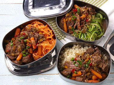 three serving dishes filled with italian petter shredded beef and side vegetables