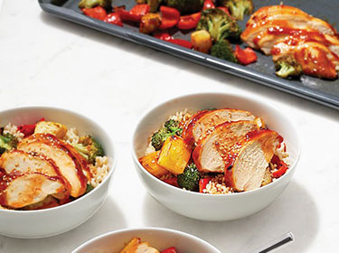 sliced chicken breasts in bowls with rice