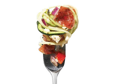 zucchini pasta salad on a fork