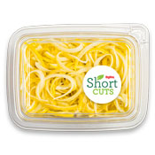 Yellow squash noodles piled up in a plastic container