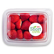 Top down view of full strawberries in a plastic container