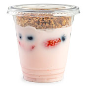 Strawberry yogurt in a cup with a granola topping and fruit mixed in the yogurt