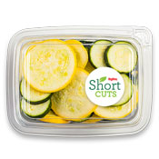 Zucchini and summer squash cut into slices and mixed together in a plastic container